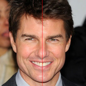 Full-face photo of Tom Cruise smiling, along with a red line over the midline of his face,for discussion about off-center porcelain veneers, from the blog of Atlanta cosmetic dentist Dr. Debra Gray King.