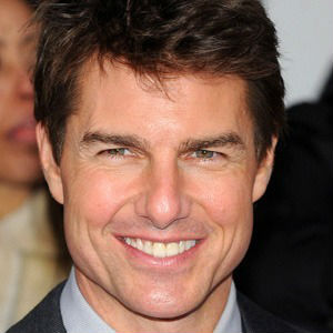 Full-face photo of Tom Cruise smiling, for discussion about off-center porcelain veneers, from the blog of Atlanta cosmetic dentist Dr. Debra Gray King.
